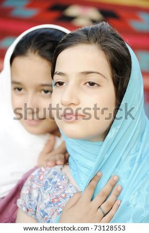 Two Arabian beautiful girls outdoor on wind - stock photo