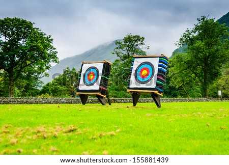 Two Archery targets in a field - stock photo