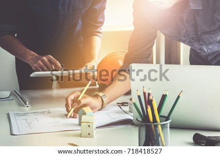 Two architect woman working compasses blueprints stock photo two architect woman working with compasses and blueprints for architectural planengineer sketching a construction malvernweather Choice Image