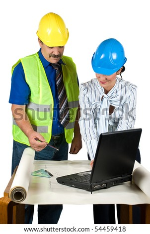 Two architects in office looking on plans , working with notebook and consulting each other about projects isolated on white background