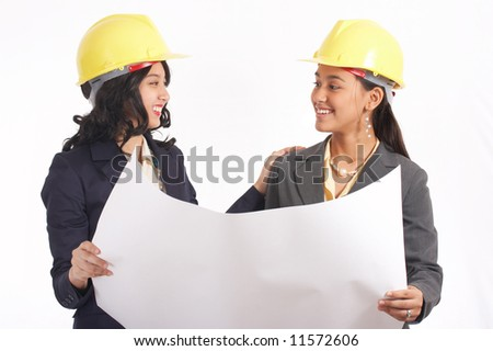 two architects smiling while looking at the plan - stock photo