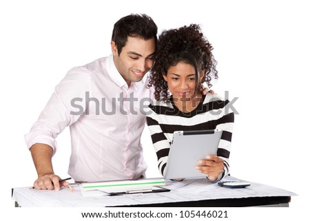 Two architects using digital tablet at work isolated on white background. - stock photo