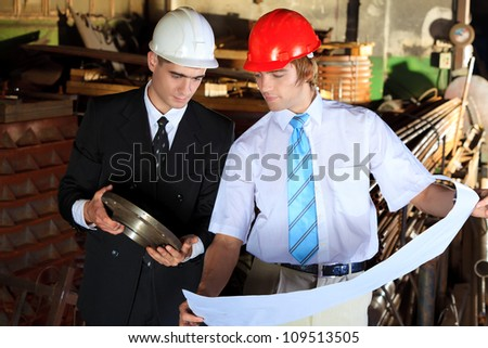 Two architectures at a manufacturing area. - stock photo