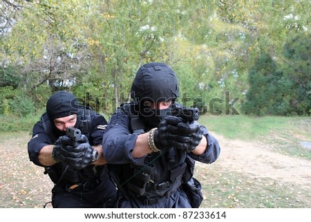 two armed policemen - stock photo