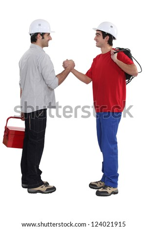 Two artisans greeting each other - stock photo