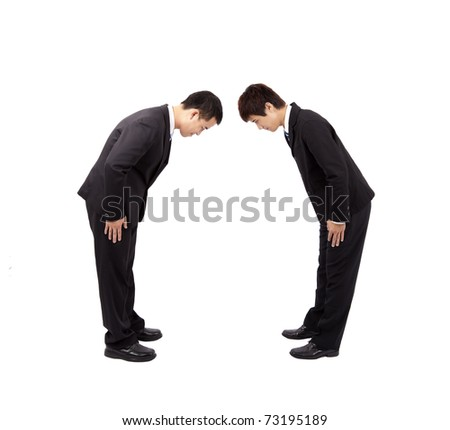 Two asian businessman with bow - stock photo