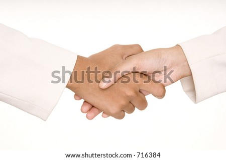Two asian businesswomen in white shake hands - stock photo