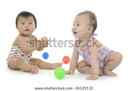 two asian children with colorful ball