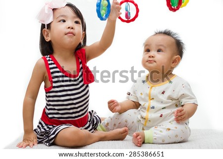 Two Asian Chinese  children playing in white background - stock photo