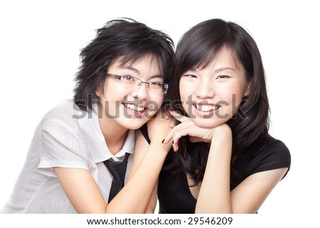 Two asian Chinese girls laughing and sharing a bonding moment - stock photo