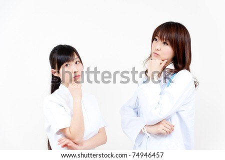 two asian doctors thinking