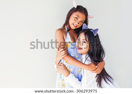 two asian girls dressed wearing cat ears - stock photo