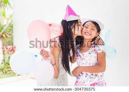 Two asian girls on a birthday party - stock photo