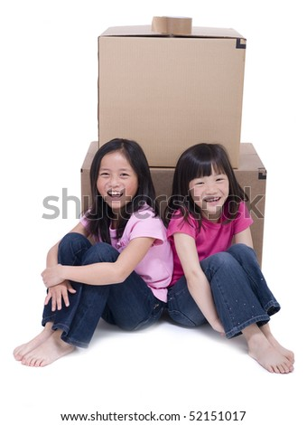 Two Asian Girls with Moving boxes isolated on white background - stock photo