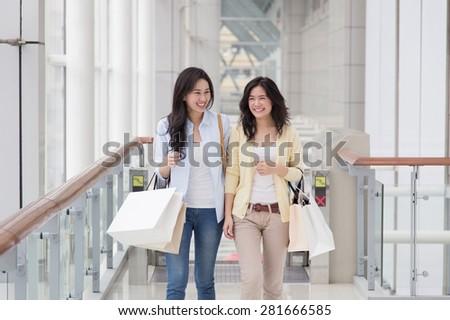 Two asian women enjoy shopping - stock photo