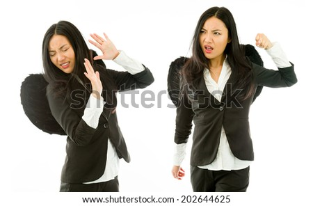 Two Asian young businesswoman dressed as black angel fighting with each other isolated on white background
