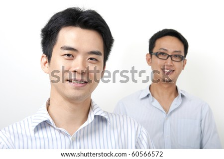 Two Asian young executives - stock photo