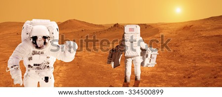 Two astronauts on Mars - Elements of this image furnished by NASA - stock photo