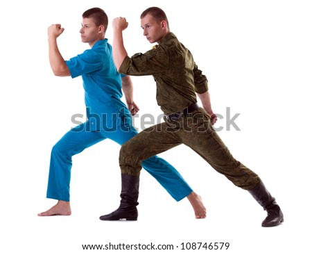 two athletic man posing in army costume isolated
