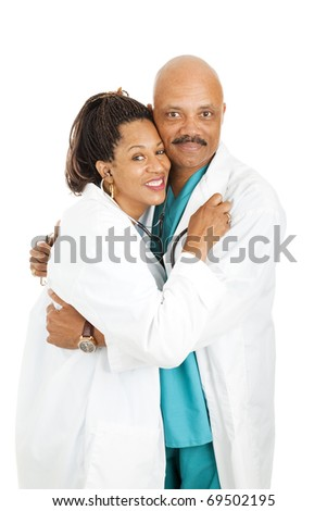 Two attractive african-american doctors having a love affair.  Isolated on white. - stock photo