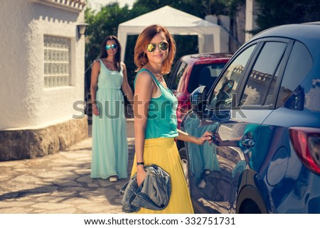 Two attractive and good looking spanish girls going shopping during holidays. Women looking at the camera. Outdoor photo. - stock photo
