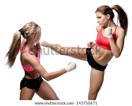 Two attractive athletic girls fighting over white background - stock photo