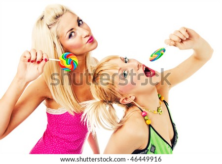 Two attractive blonde models posing with lollipops - stock photo