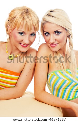 Two attractive blondes looking at the camera - stock photo