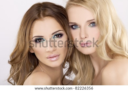 Two attractive girl friends - blond and brunette - stock photo