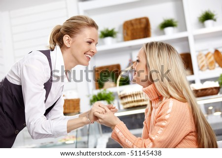 Two attractive girlfriends have met in cafe - stock photo
