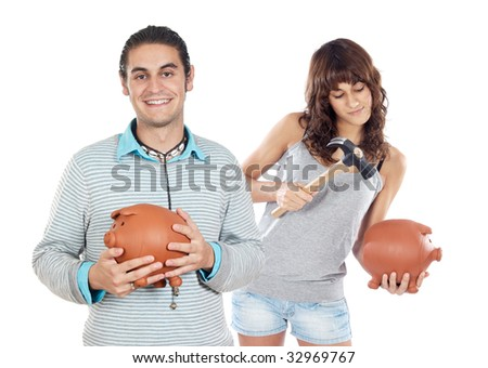 Two attractive girls with money box on a over white background - stock photo