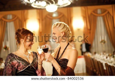 Two attractive ladies on a party