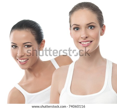 two attractive smiling women isolated on white - stock photo
