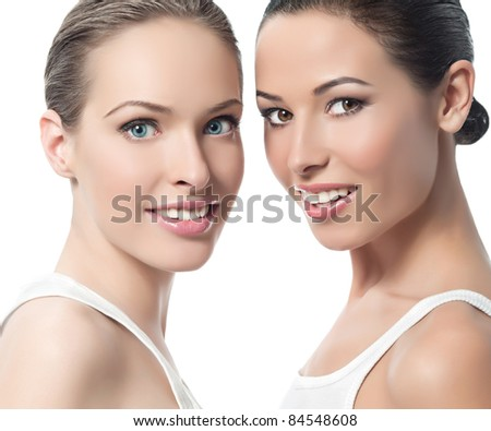 two attractive smiling women  on white background - stock photo