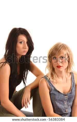 Two attractive teenage girls posing together for portraits