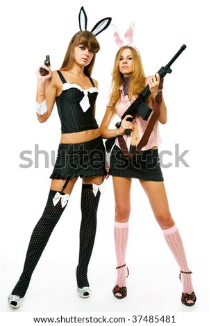 two attractive young woman in a sexy outfits with guns isolated on a white background - stock photo
