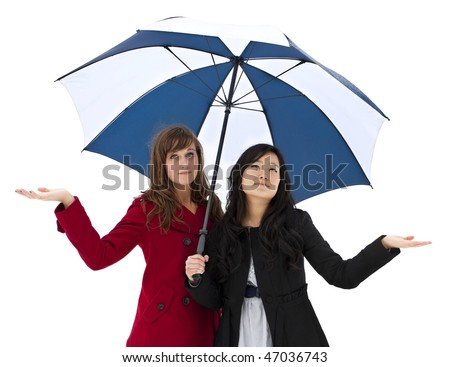 Two attractive young women are sad to see the raining weather again - stock photo
