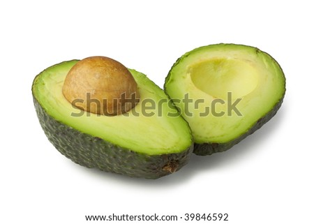 Two avocado halves laying side by side - stock photo