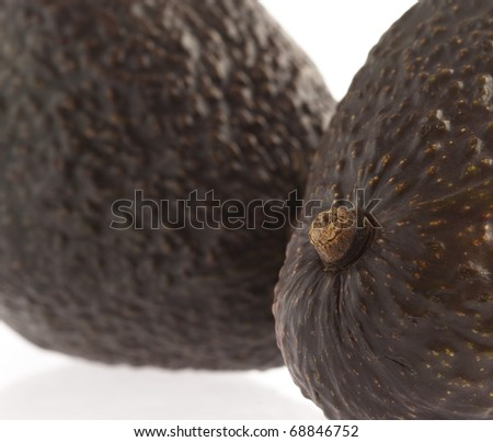 two avocados closeup, on a white background