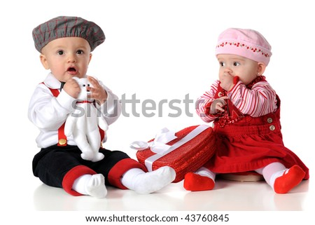 Two babies dressed up for a Valentine's Day date.  Isolated on white. - stock photo