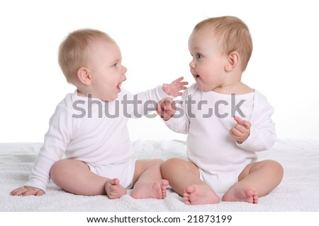 two babies talking - stock photo