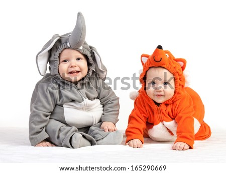 Two baby boys dressed in animal costumes over white - stock photo