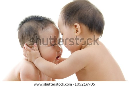 Two baby boys playing with each other, isolated on white background - stock photo