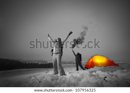 Two backpackers asking a help in a winter field