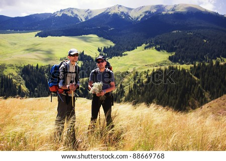 Two backpackers in the summer mountain