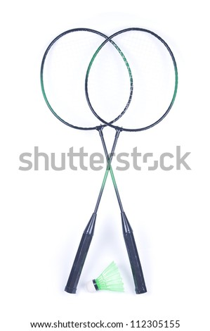 Two badminton rackets and a shuttlecock isolated over white - stock photo