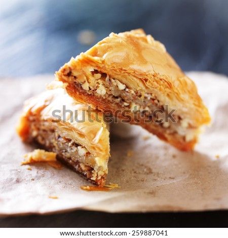 two baklava halves sitting on wax paper - stock photo