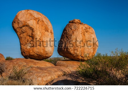 Two balancing boulders in the Devils Marbles Conservation Reserve, Northern Territory, Australia