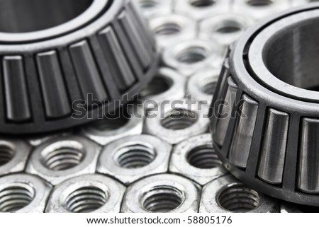 Two ball bearings on a industrial background - stock photo