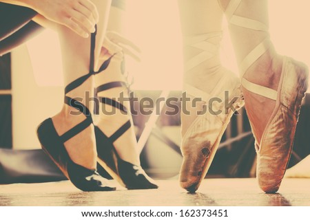 two ballerinas  in ballet shoes  put trough arty retro filter